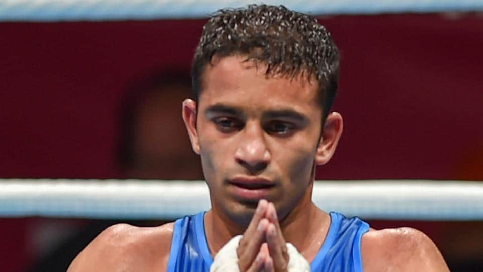Jakarta: India's Amit Panghal gestures after he was declared winner against Paalam Carlo. (PTI)