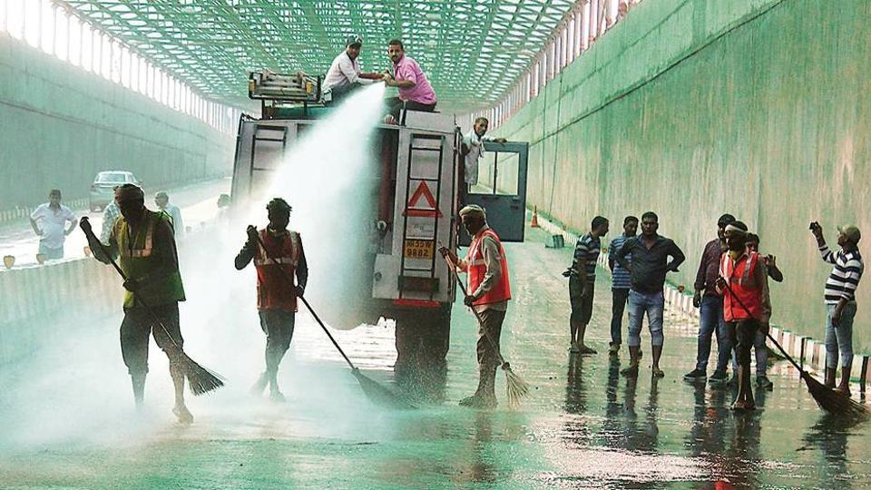 MCG workers clean the Hero Honda Chowk underpass on Thursday.