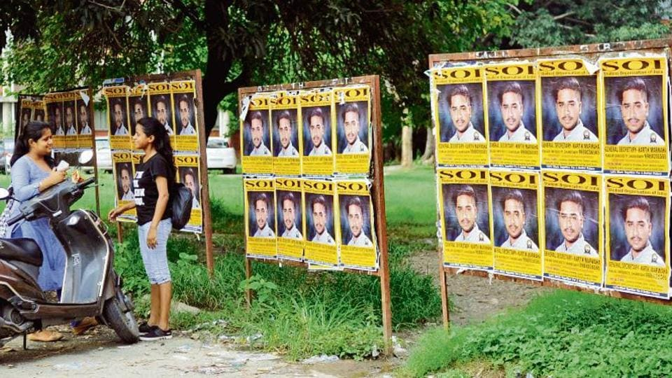 Posters in a parking area at Panjab University in Chandigarh on Thursday. According to the code of conduct, the student parties cannot use printed material for canvassing.