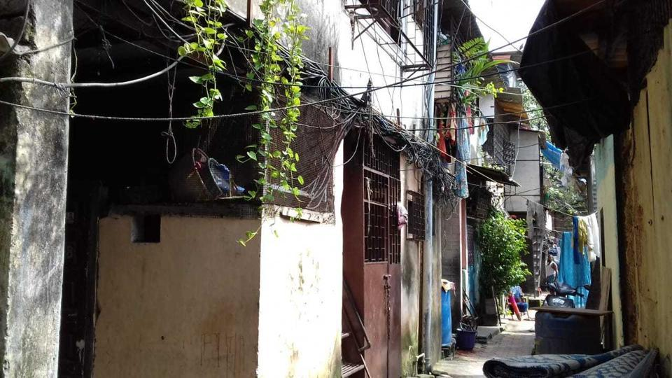 Rahat Plaza in Sion where three committee members were recently suspended for having more than two children.  Originally a colonial-era chawl with 87 housing units, it is currently registered as a single society.