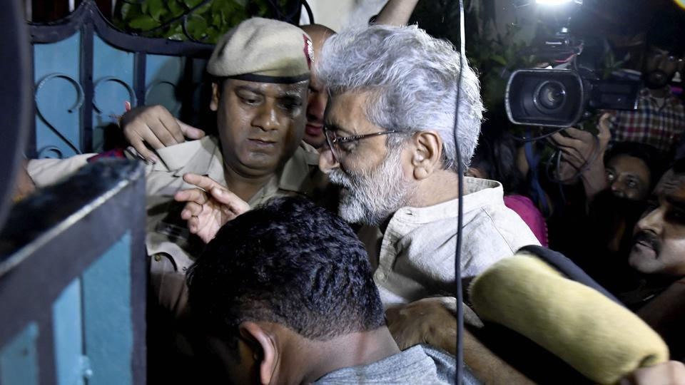 Human rights activist Gautam Navlakha at his residence after he was arrested by the Pune police in connection with the Bhima Koregaon violence, in New Delhi on Tuesday.