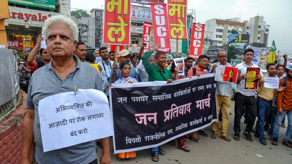Social activists and filmmakers hold placards during a protest against the raid at activist Stan Swamy's residence, in Ranchi on August 30, 2018. A police team from Maharashtra had also raided social activist Stan Swami's residence and seized his computer, mobile phone and several documents in connection with the probe into the Bhima-Koregaon violence. (PTI)