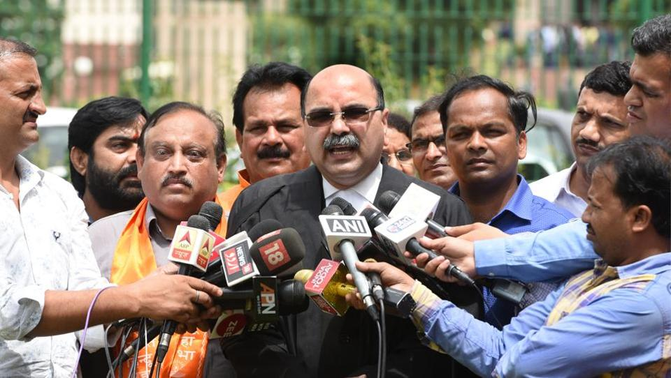 Advocate Barun Kumar Sinha speaks to the media about Article 35A. The Supreme Court put off hearing petitions against the Constitution's Article 35A to January after the Centre and the Jammu and Kashmir government argued that it could lead to a law and order situation in the state ahead of the coming panchayat and local body elections. (Sushil Kumar / HT Photo)