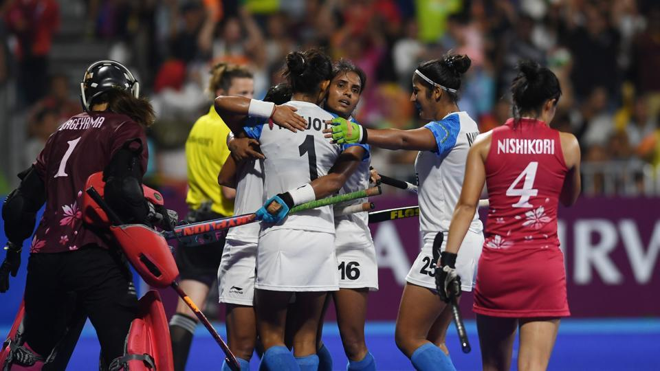 India's players celebrate after score a goal against Japan during the women's field hockey final match between India and Japan. (AFP)