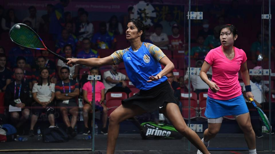 Hong Kong's Annie Au Wing-chi (in pink) competes against India's Joshana Chinappa (in blue) during the women's pool B squash team event at the 2018 Asian Games in Jakarta on August 30, 2018.