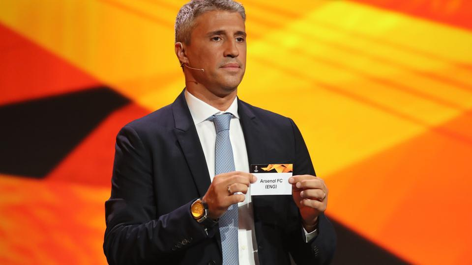 Former Argentinian footballer Hernan Crespo holds the slip of Arsenal during the draw for UEFA Europa League football tournament at The Grimaldi Forum in Monaco on August 31, 2018.