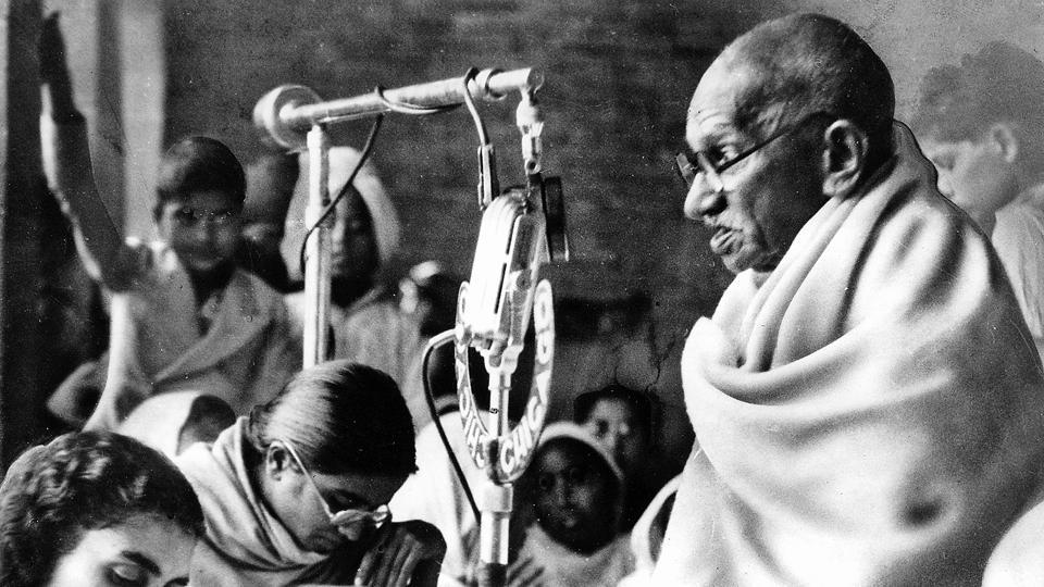 Mahatma Gandhi, wrapped in his white shawl, sits before a microphone to speak at a prayer meeting in New Delhi. It was the second day of Gandhi's fast (January 14, 1948) for communal peace. He ended his fast on January 18 after being given a pledge of harmony by leaders of different communities.