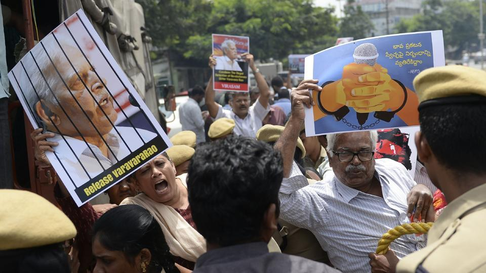 "Activists of the Communist Party of India (Marxist-Leninist) New Democracy shout slogans during a protest against the arrest of poet and activist Varavara Rao in Hyderabad, on August 29, 2018. Rao on Thursday said the Supreme Court order asking the Pune police to return him home in Hyderabad was a ""slap on the face of the government"". (Noah Seelam / AFP)"
