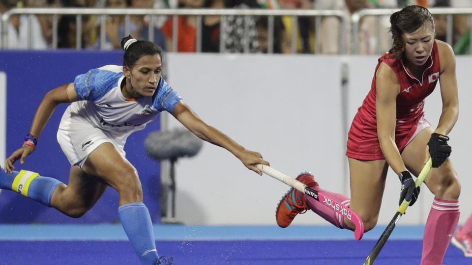 Japan's Kimika Hoshi, right, during their women's hockey match for gold against India at the 18th Asian Games. (AP)