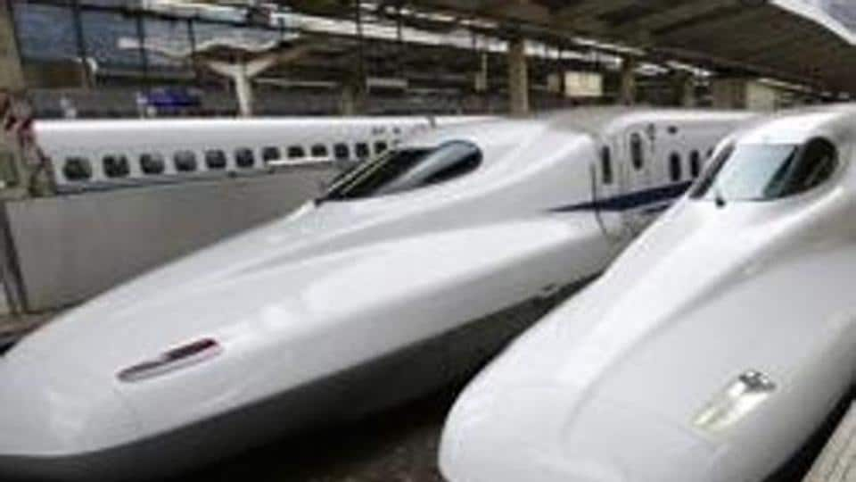 FILE - In this Sept. 24, 2014 filephoto, passengers get on the Shinkansen high-speed train at Tokyo station in Tokyo.