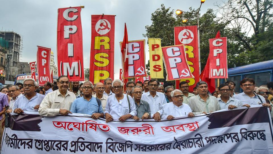 Left Front Chairman Biman Bose and other activists participate in a rally to protest against the raids, in Kolkata on August 30, 2018. A three-judge SC bench headed by chief justice of India Dipak Misra also asked the Maharashtra government to file a response by September 5 to a petition by historian Romila Thapar and others that alleged the arrests were aimed at muzzling dissent. (Swapan Mahapatra / PTI)