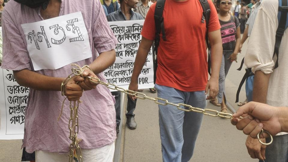 Citizens under Association for Protection of Democratic Rights (APDR) banner walk chained during a protest rally against the arrests, in Kolkata on August 29, 2018. Charged with criminal conspiracy, creating fear and enmity between various groups, and under the Unlawful Activities (Prevention) Act, those arrested on Tuesday were being brought to Pune on transit remand to be produced in the court on Wednesday. (Samir Jana / HT Photo)