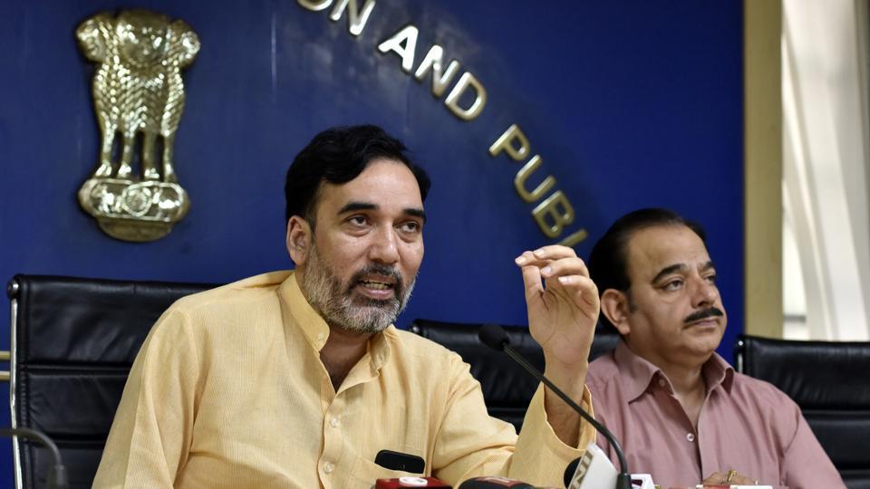 Fiel photo of Delhi 's development minister labour minister Gopal Rai (L).