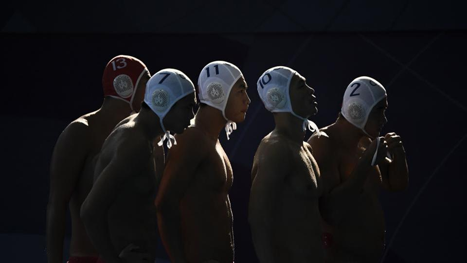 China's players prepare to compete in their men's water polo group B match against Hong Kong during the 2018 Asian Games in Jakarta, Indonesia. (Fred Dufour / AFP)