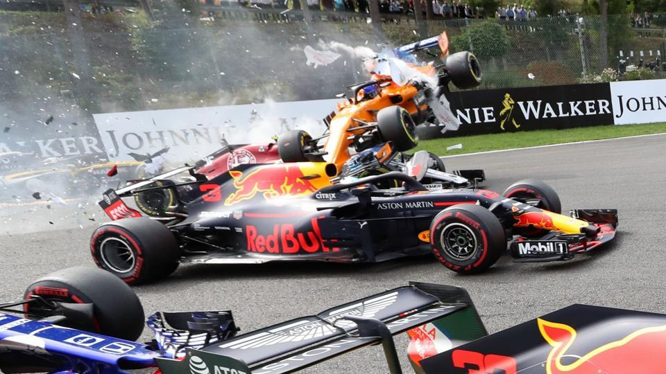 McLaren's Spanish driver Fernando Alonso (back) crashes during the Belgian Formula One Grand Prix at the Spa-Francorchamps circuit in Spa, Belgium. (Benoit Doppagne / Belga / AFP)