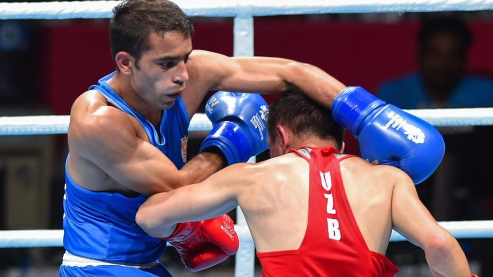 India's Amit Panghal (in blue) in a match against Uzbekistan's Hasanboy Dusmatov during the Men's light fly (46-49kg) boxing final bout at the 18th Asian Games 2018. (PTI)