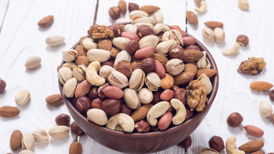 Whether it is peanuts or walnuts, nuts are a good source of magnesium and vitamins. Magnesium regulates serotonin, the feel-good chemical in your brain and reduced bloating. Walnuts are also a good source of Omega 3 fatty acids.  (Shutterstock)