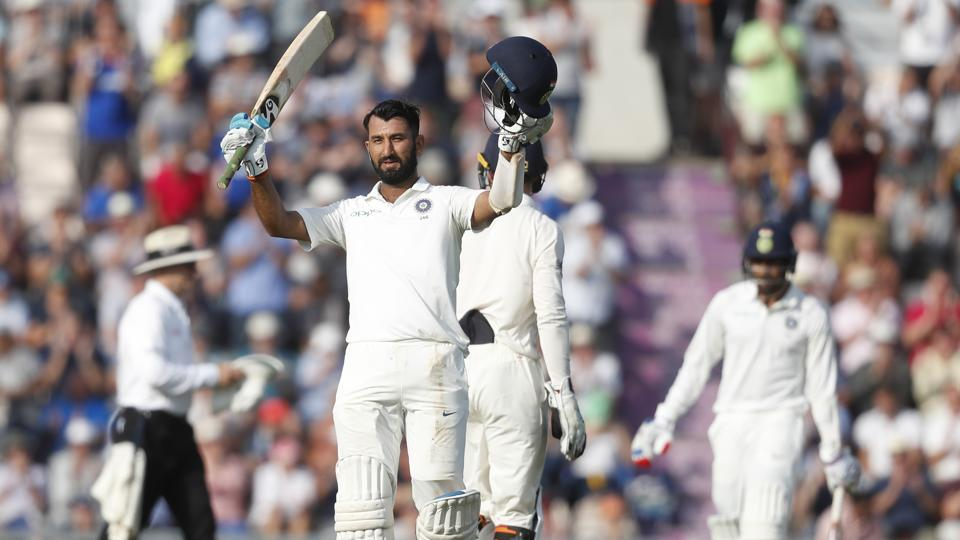 India's Cheteshwar Pujara celebrates after reaching his century on Day 2 of the fourth Test against England. (AP)