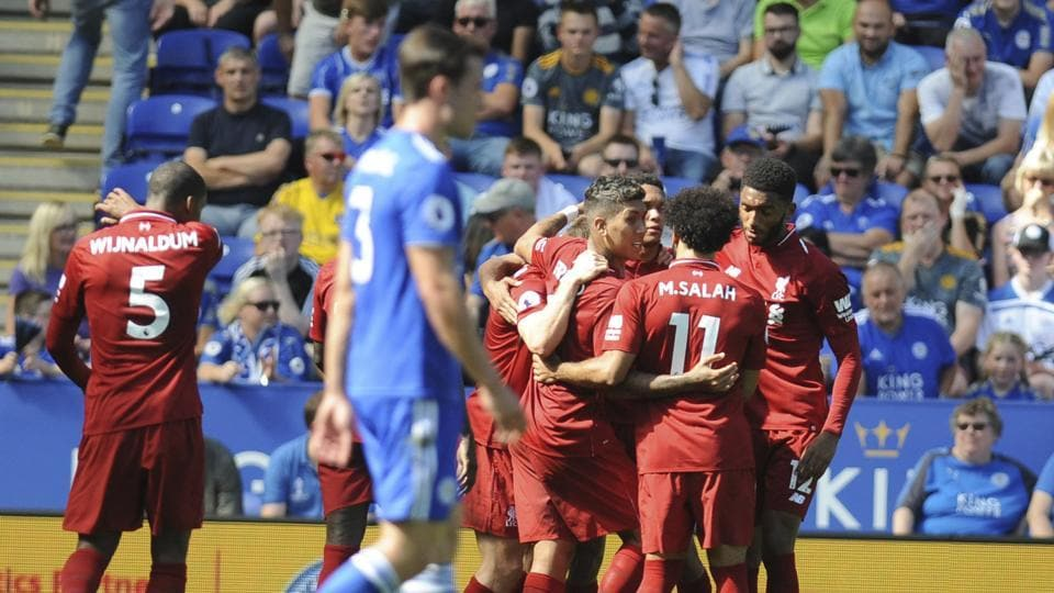 Liverpool's Roberto Firmino, centre, celebrates scoring his sides' second goal during the English Premier League soccer match between Leicester City and Liverpool at the King Power Stadium.