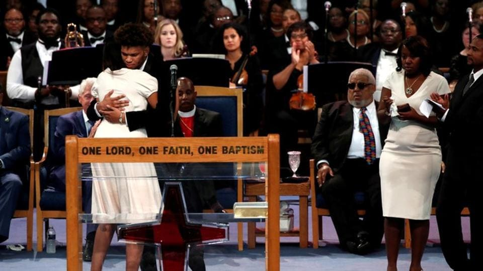 Jordan Franklin, grandson of Aretha Franklin, is comforted by Victorie Franklin as he speaks at the funeral service for Aretha Franklin t the Greater Grace Temple in Detroit, Michigan, U.S.