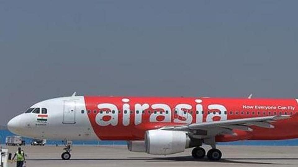 This photograph taken on March 8, 2018 shows an airplane of Air Asia, the low-cost airline headquartered in Malaysia, taxiing before take-off at the Kempe Gowda International Airport in Bangalore.