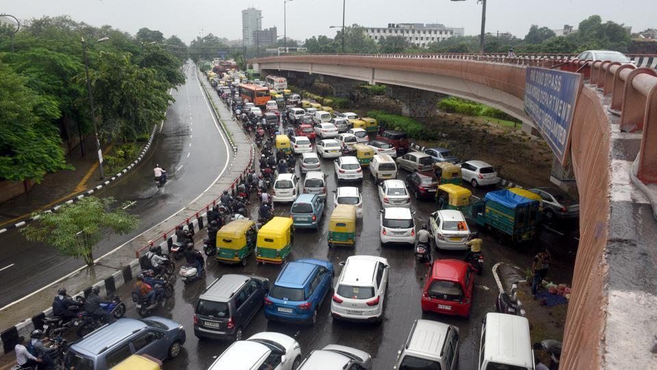 Several parts of Delhi witnessed bumper to bumper traffic like here on the Ring Road, or were bogged down due to vehicles moving slowly on waterlogged roads. (Sonu Mehta / HT Photo)