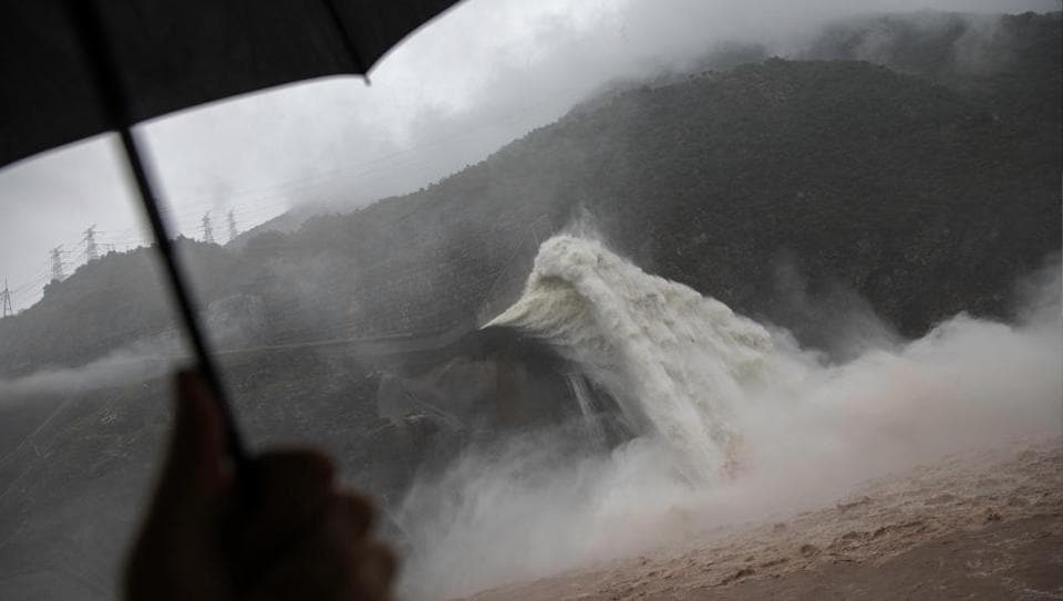 Water is released as heavy rain falls at Pubugou Dam on the Dadu river, a tributary of the Yangtze in Sichuan province, China. Authorities demolished seven small dam projects this year in the province to clear illegal developments in a new nature reserve, part of a nationwide programme to close hundreds of tiny and often ramshackle dams and turbines and bring order to China's massive hydropower sector. (Damir Sagolj / REUTERS)
