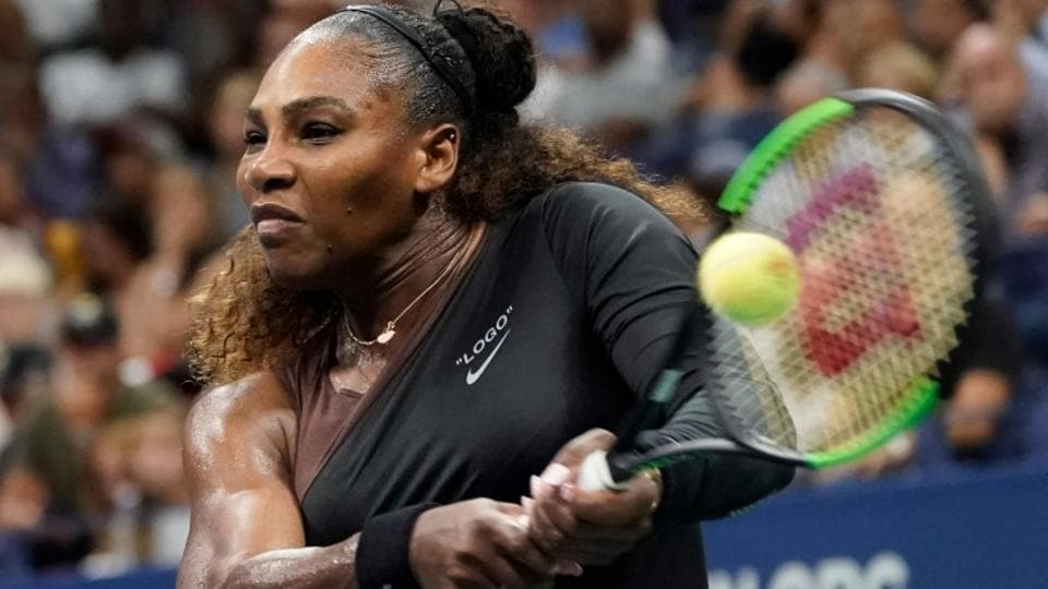 Serena Williams hits to Venus Williams in a third round match at the USOpen.