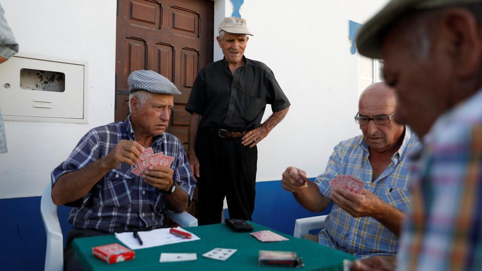 Old men play cards on a street in Amieira, Portugal. The 5 billion euro ($5.8 billion) irrigation project on the River Guadiana, begun two decades ago to revive a region at risk of desertification, is only now reaching its initial design capacity and there are plans to expand it further. It has also boosted income and jobs in the most disadvantaged region of Western Europe's poorest country. (Rafael Marchante / REUTERS)