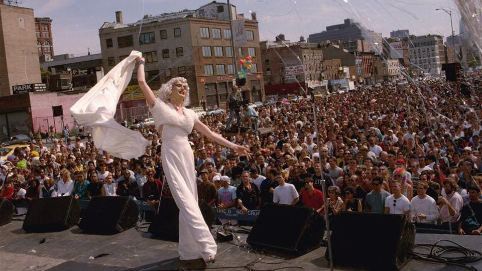 Drag queen Cloud performs on stage at Wigstock '94 in New York. With Tony, Emmy and Oscar award winners involved in the production, drag culture has gone mainstream. And Wigstock has come a long way from the wee hours one night in 1984 when Lady Bunny led the inebriated charge into the park. (Paul Hurschmann / AP File)