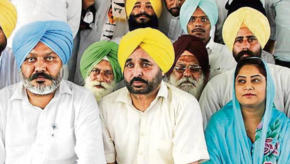 Punjab leader of opposition Harpal Singh Cheema and Sangrur MP Bhagwant Mann during a rally in Bathinda on Sunday.