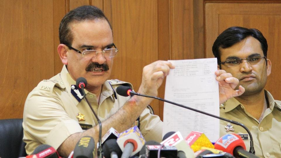 Maharashtra ADG Param Bir Singh with Pune's Additional CP Shivaji Bodke (L)Dr.Shivaji Pawar(R) adressed a press conference about the house arrest of rights activists in Bhima Koregaon case, at DGP office, in Mumbai on Friday.