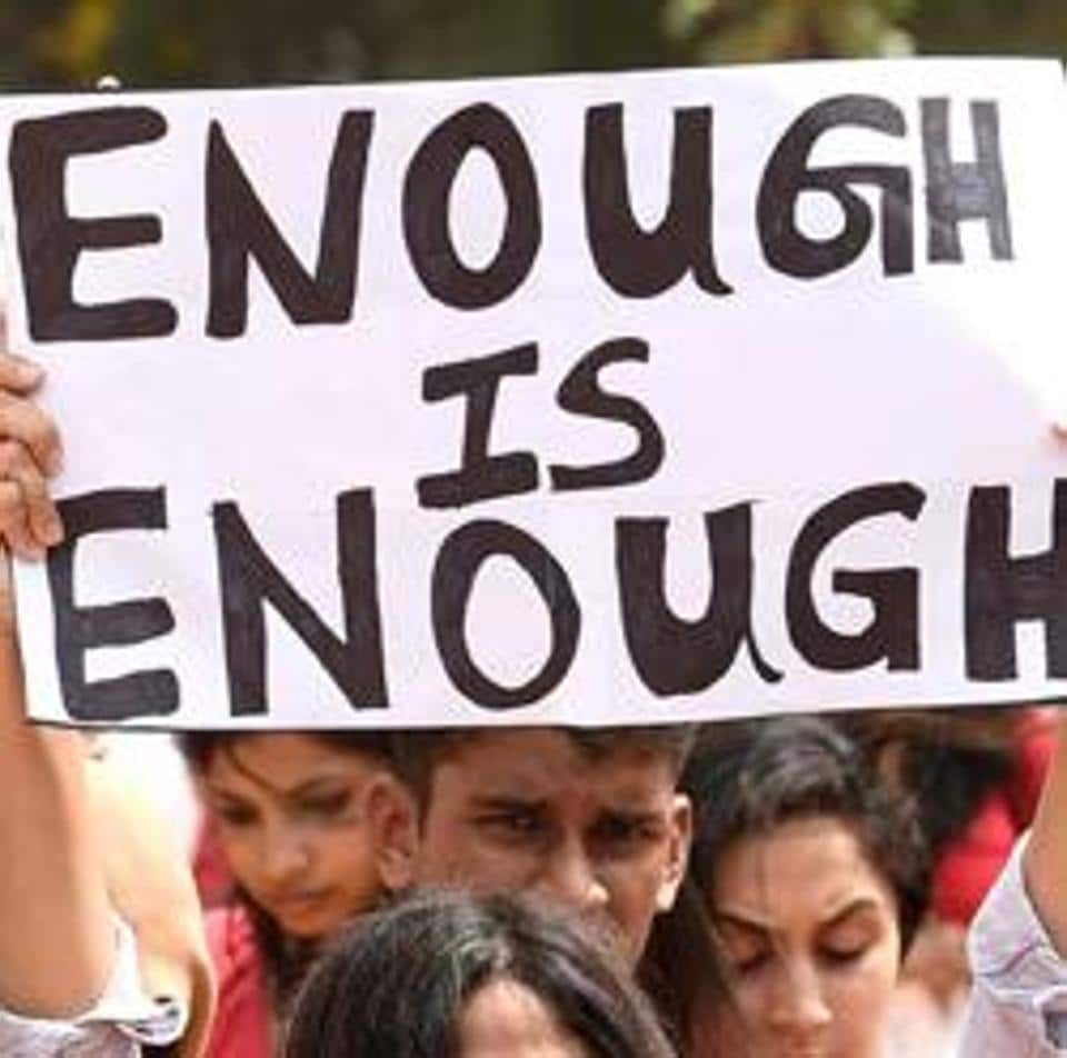 Activists hold placard at a rally in Bengaluru to protest incidents of sexual violence against women.