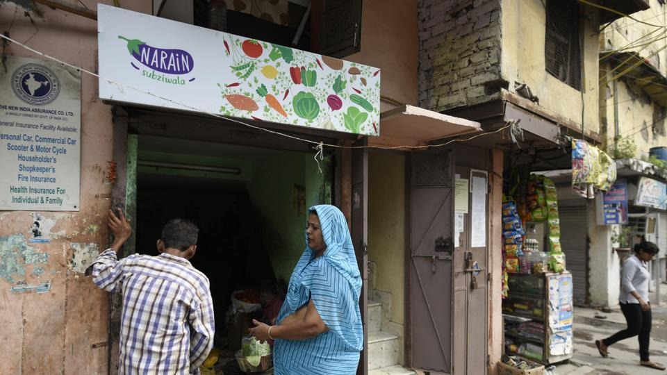 Narain Sabjiwala's shop has a got signage for the first time --a simple design that has Narain written on a brinjal as a logo alongside other vegetables. Aanchal Baranwal, a Delhi-based multidisciplinary designer who did the branding said she realised during her conversations with the vendor that coriander and chilli is every customer's demand, so she highlighted them in the background to show how they go with everything. (Burhaan Kinu / HT Photo)