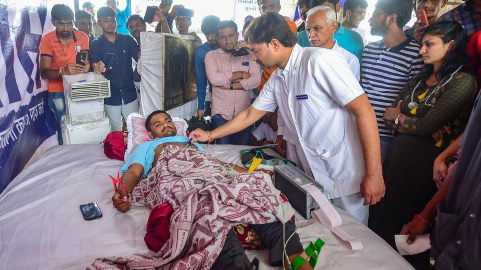 As Patidar leader Hardik Patel's fast unto death entered the 9th day on Sunday, he said he has made his will, anticipating he may die of hunger following no response from the state government to his agitation. His parents, a gaushala (cow shelter) and kin of 14 Patidar youths who died in violent protests three years ago have been named as inheritors of his will. (Santosh Hirlekar / PTI File)