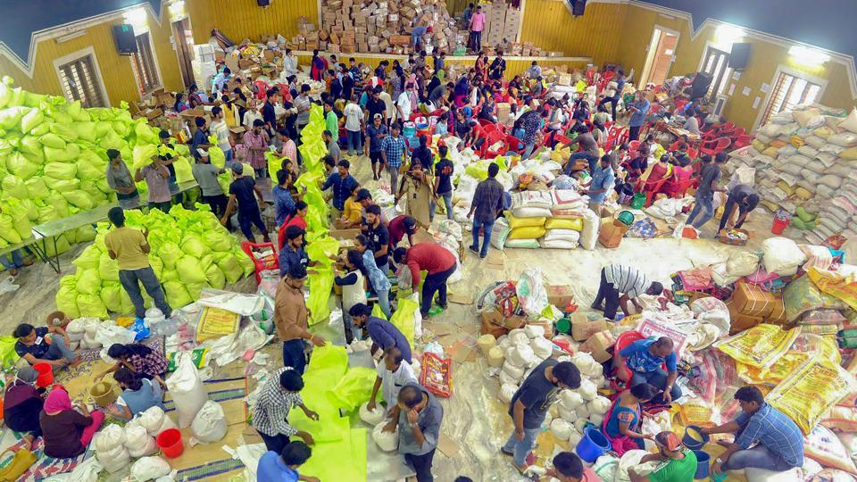 Volunteers segregate flood relief material at a distribution centre for Kerala floods, in Kochi on Sunday. Thomas Isaac said  the revenue would be raised through various means, including cash and kind.