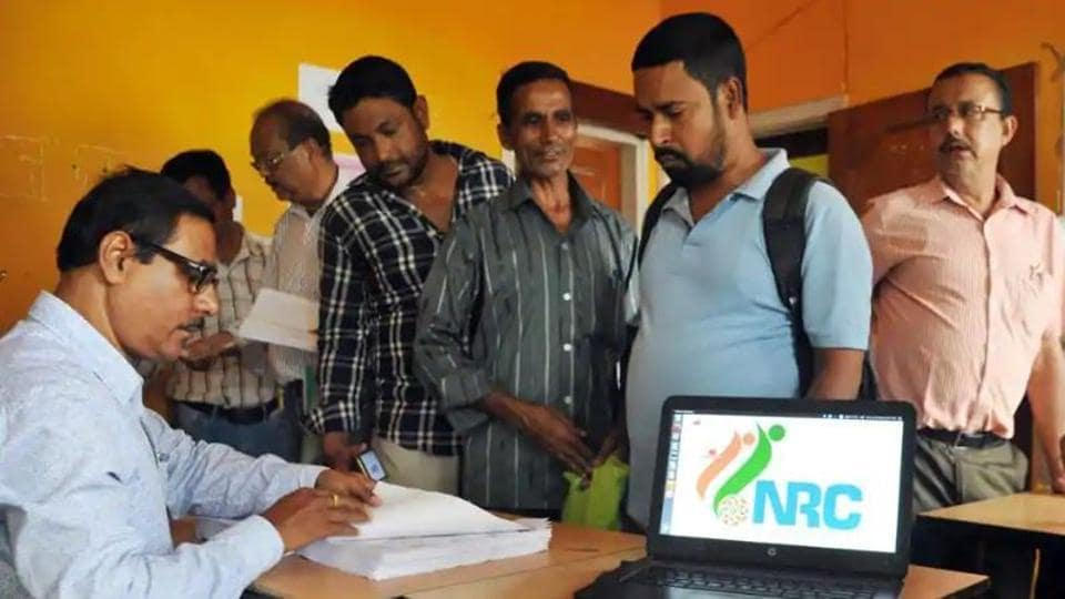 People checking their names on the final draft list of the state's National Register of Citizens in Guwahati.