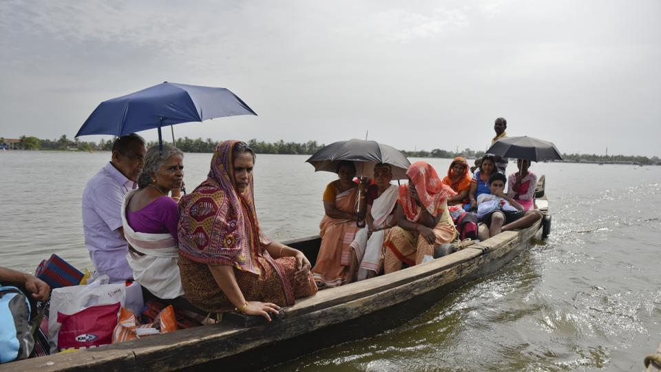 Flood affected people who had taken refuge in relief camps return to their houses in Kuttanad, Alappuzha in Kerala, India, on August 27, 2018. More than 400 people died and 800,000 were displaced by the worst monsoon flooding in a century in the southern state.