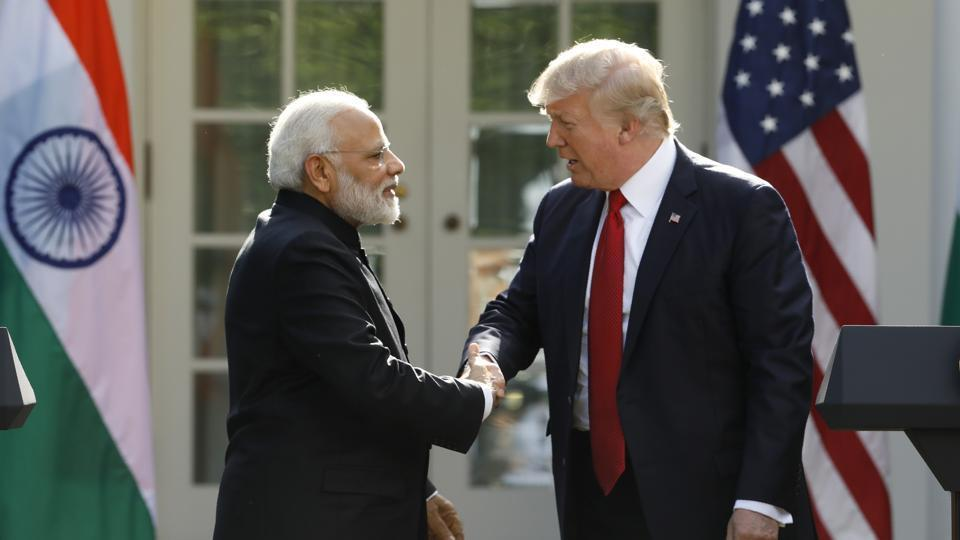 US President Donald Trump (right) greets Prime Minister Narendra Modi during their joint news conference at the White House in Washington.
