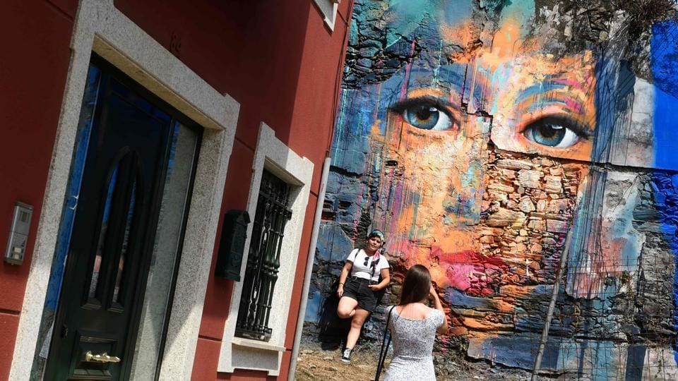 """A mural seen during the annual street art festival """"Meninas de Canido"""" set up in 2008 in Ferrol, Spain. Sick of watching his derelict neighbourhood dying a slow death, Spanish artist Eduardo Hermida walked out of his studio and painted a mural inspired by Diego Velazquez's masterpiece """"Las Meninas"""" in 2008. (Miguel Riopa / AFP)"""