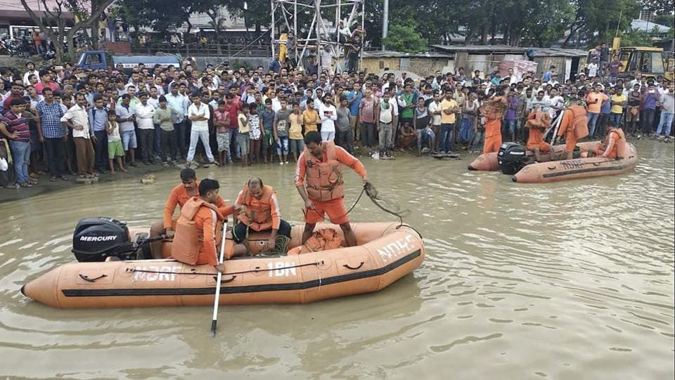 At least two people were killed as a boat with around 40 people on board capsized in the Brahmaputra river in Guwahati on Wednesday. It was single-engine private boat, locally called a 'bhutbhuti', which plied from Fancy Bazar in north Guwahati to a ghat on the other side of the river next to the ancient Aswaklanta Temple. (Anupam Nath / AP)