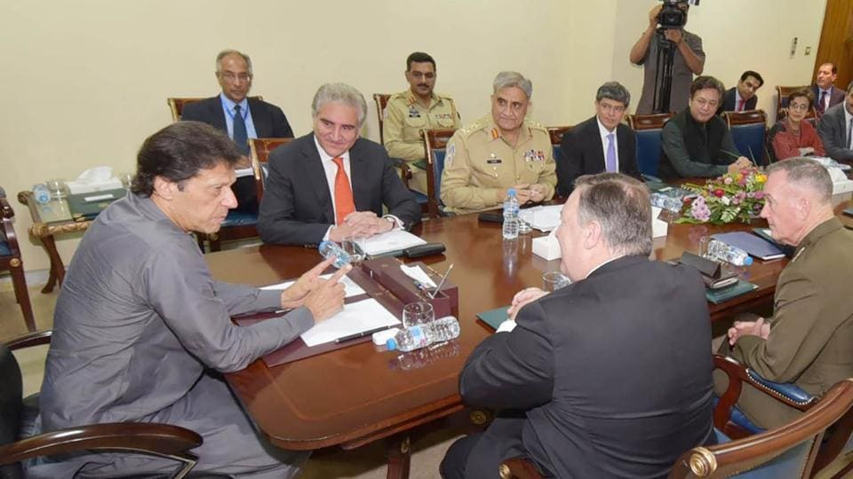 US Secretary of State Mike Pompeo (2R) and Pakistani foreign minister Shah Mahmood Qureshi (C/L) listen as Pakistani Prime Minister Imran Khan (L) speaks during a meeting at the Prime Minister's Office in Islamabad on September 5.