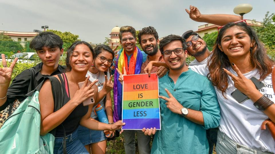 People react after the Supreme Court verdict which decriminalises consensual gay sex, outside the Supreme Court in New Delhi.