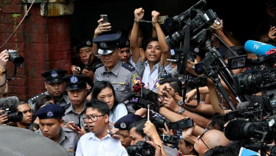 Detained Reuters journalists Wa Lone and Kyaw Soe Oo leave Insein court after listening to the verdict sentencing them to seven years in prison, in Yangon, Myanmar. (REUTERS)