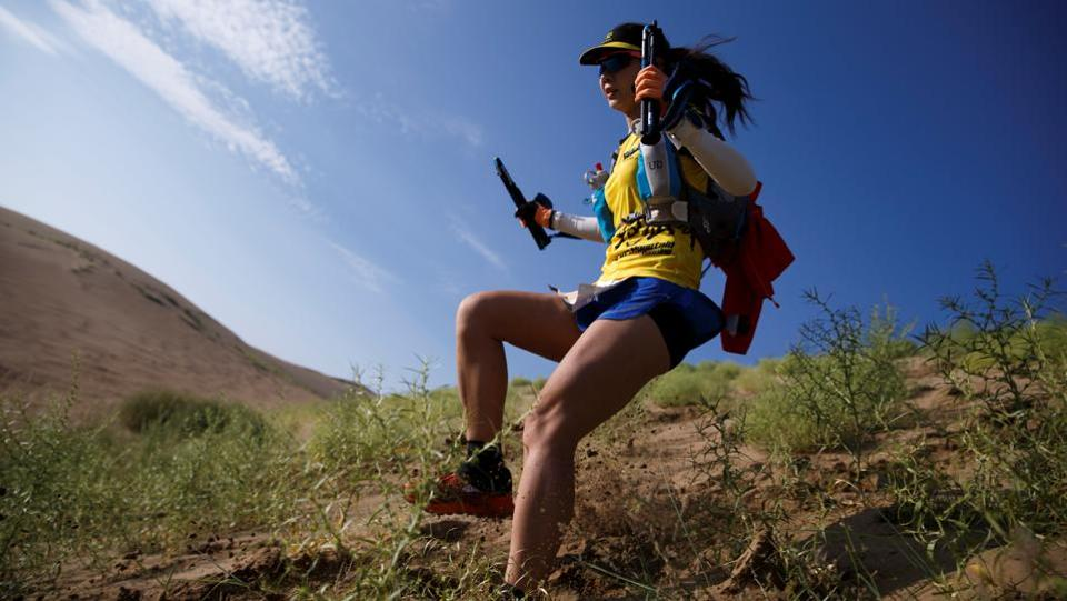 When Dou Jianyun, 45, wanted more time for trail running, she took a job in sales at a Beijing-based sportswear startup. One of only three female runners to make it to the finish line for the race, she brought three GPS systems with her and new walking poles to guard against injury on the rocky trails. (Thomas Peter / REUTERS)