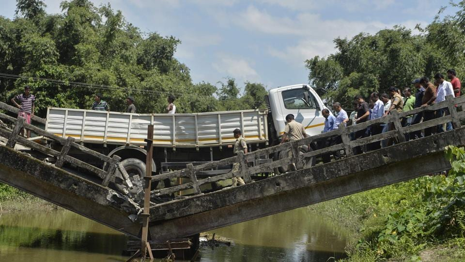 An old bridge collapsed near Siliguri in north Bengal, leaving a truck driver injured, a state minister said. This is the second incident of bridge collapse in the state in three days. The Majerhat Bridge collapsed in South Kolkata on September 4, killing three persons and injuring 24. (Diptendu Dutta / AFP)