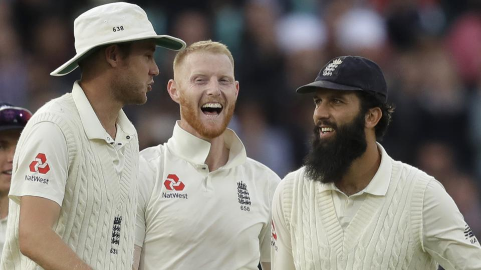 England's Ben Stokes, center, celebrates taking the wicket of India wicketkeeper Rishabh Pant at the Oval.