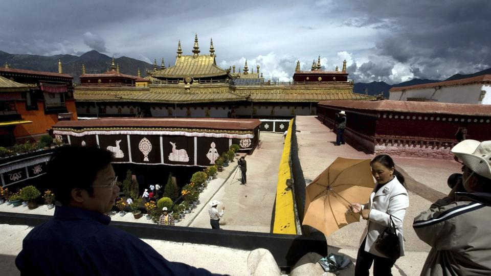 FILE - In this July 27, 2007, file photo, tourists visit the Jokhang Monastery, one of the oldest Tibetan monasteries in Lhasa in China's Tibet Autonomous Region.