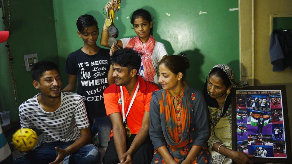 Harish with his family members at their home. Some aid came in the form of a sponsorship for Harish's training from the Sports Authority of India and their assistance in monthly finances along with providing sports kits. (Vipin Kumar / HT Photo)