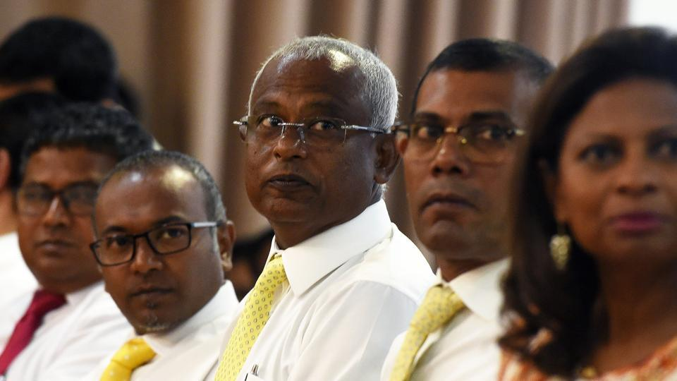 Maldives' main opposition leader and presidential candidate Ibrahim Mohamed Solih (C) and Maldives' self-imposed exiled former president Mohamed Nasheed (2nd R) attend a meeting at Mount Lavinia, a suburb of Colombo, on August 27, 2018.